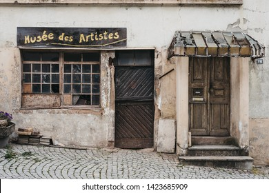 Vianden, Luxembourg - May 18, 2019: Facade of an abandoned Musee des Artistes in Vianden, town in Luxembourgs Ardennes region known for the centuries-old hilltop Vianden Castle.