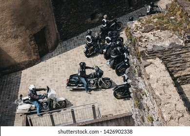 Vianden, Luxembourg - May 18, 2019: Gunfighters bikers riding on a road within Vianden Castle, Luxembourg, one of the largest and finest feudal residences of the Roman and Gothic eras in Europe.