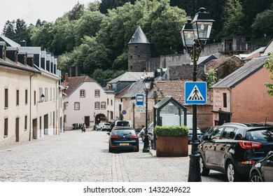 Vianden, Luxembourg - May 18, 2019: Cars on a cobblestone street in Vianden, town in Luxembourgs Ardennes region known for the centuries-old hilltop Vianden Castle.