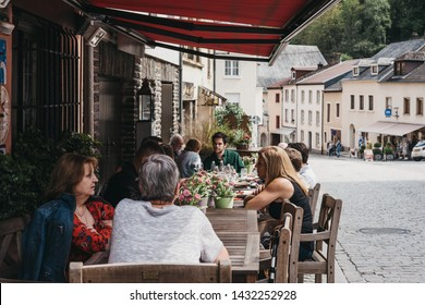 Vianden, Luxembourg - May 18, 2019: Close up of people sitting at the outdoor tables of a restaurant in Vianden, town in Luxembourgs Ardennes region known for the centuries-old hilltop Vianden Castle.