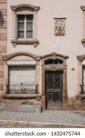 Vianden, Luxembourg - May 18, 2019: Facade of an old Luxembourgish house in Vianden, town in Luxembourgs Ardennes region known for the centuries-old hilltop Vianden Castle.