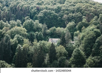 Vianden, Luxembourg - May 18, 2019: House located remotely amidst greenery in Vianden, town in Luxembourg's Ardennes region known for the centuries-old hilltop Vianden Castle.