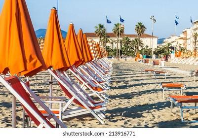 Viareggio beach with colorful umbrellas sunset.Tuscany,Viareggio, Italy.Versilia cost panorama.