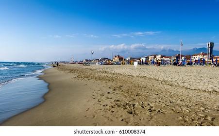 Viareggio beach with colorful umbrellas sunset.Tuscany,Viareggio, Italy.Versilia cost panorama.