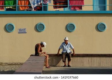 Viareggio, Italy - 05/25/2008: Versilia: Retired couple at bathing establishments on the beach of Viareggio