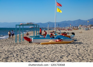 Viareggio, Italy - 09/28/2018: Late Afternoon on the Beach in the Resort Town of Viareggio