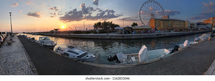 Viareggio, Italy - August 18th 2018: the promenade of Viareggio an Italian citt near the sea in Italy, full of tourists in summer, On background the ferry wheel.