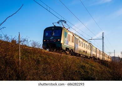 Viareggio Italy: December 2016: Trenitalia. Train from Viareggio to Lucca passing through the countryside of Massarosa, Pioppogatto. Locomotive AL 582