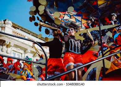 VIAREGGIO, ITALY - FEB 11: Festival, the parade of carnival floats with dancing people on streets of Viareggio. February 11, 2018, taken in Viareggio, Italy