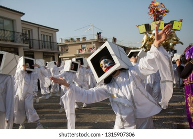 VIAREGGIO, ITALY - FEB 17: Festival, the parade of carnival floats with dancing people on streets of Viareggio. February 17, 2018, taken in Viareggio, Italy
