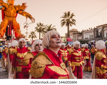 VIAREGGIO, ITALY: FEB. 23, 2019 People dancing around the allegorical float on the path of Viareggio at the Carnival of Viareggio.Viareggio is considered one of the most important carnivals in Italy.