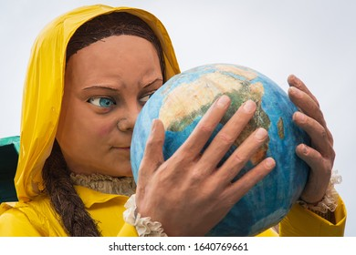 VIAREGGIO, ITALY - FEBRUARY 09, 2020:  Greta Thunberg is a mask of the parade of carnival floats on streets of Viareggio, Italy. Carnival of Viareggio is considered one of the most important carnivals