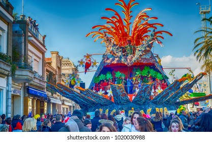 VIAREGGIO, ITALY - FEBRUARY 10, 2013: People enjoy carnival parade in Viareggio. This is the most famous carnival in Tuscany.