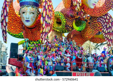 VIAREGGIO, ITALY - FEBRUARY 10, 2013: People enjoy carnival parade. This is the main carnival of Tuscany.