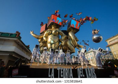 VIAREGGIO, ITALY - FEBRUARY 18: Festival, the parade of carnival floats with dancing people on streets of Viareggio. February 18, 2019, taken in Viareggio, Italy