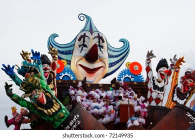 VIAREGGIO, ITALY -  FEBRUARY 21: Clown statues on a Happiness themed float during Carnival of Viareggio, one of the most famous in the world on February 21, 2010 in Viareggio, Italy