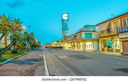 VIAREGGIO, ITALY - MARCH 2014: City streets at sunset. Viareggio is a famous destination city in Tuscany.