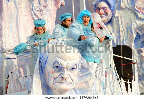 VIAREGGIO, ITALY - MARCH 4, 2012: Festive procession during the renowned Viareggio carnival parade. Spectacular floats depicting caricatures of popular politicians, celebrities or current events.