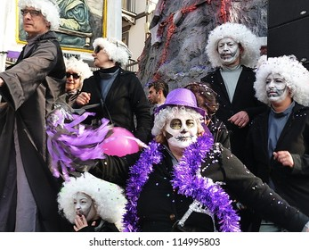 VIAREGGIO, ITALY - MARCH 4 An undefined woman in carnival mask at the parades on the promenade during the famous annual Italian Carnival of Viareggio on march 4, 2012 in Viareggio, Italy