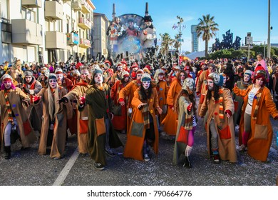 VIAREGGIO, ITALY - MARCH 6: Festival, the parade of carnival floats with dancing people on streets of Viareggio. March 6, 2013, taken in Viareggio, Italy