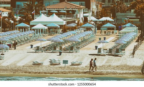 VIAREGGIO, ITALY - MAY 30, 2015: Row of beach umbrellas on private bathhouse. Viareggio is a famous destination in Tuscany.