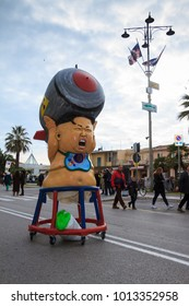 Viareggio, January 2018:  Kim Jong-un-baby with a big bomb, caricature on carnival parade of floats and masks, made of paper-pulp, on January 2018 in Viareggio, Tuscany, Italy