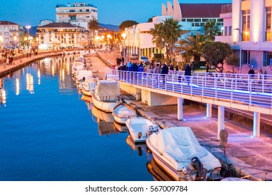 Viareggio, Tuscany. Boats along city canal at night.