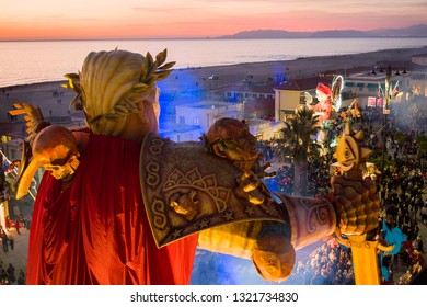 """VIAREGGIO,ITALY-23 FEN,2019: A giant paper-mache called """"dazi nostri """" is dedicated to donald trump depicted as a  giant transformer cartoon and the commercial  tax war of america against the world"""