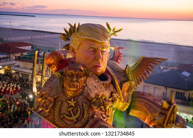 "VIAREGGIO,ITALY-23 FEN,2019: A giant paper-mache called ""dazi nostri "" is dedicated to donald trump depicted as a  giant transformer cartoon and the commercial  tax war of america against the world"