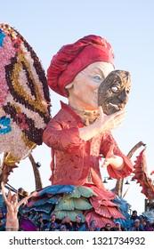 VIAREGGIO,ITALY-FEB.23,2019: mask and float takes part in the third parade of the 2019 edition of the viareggio's carnival.