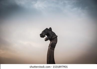Viborg, Russia - 10/13/2018: Viking ship carved dragon heads modern wooden drakkar vikings