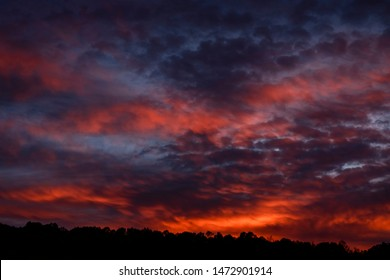 Vibrant afterglow of an Appalachian sunset over a ridge in  Webster County, West Virginia, USA