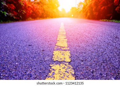 vibrant asphalt road with purple road and yellow lane.