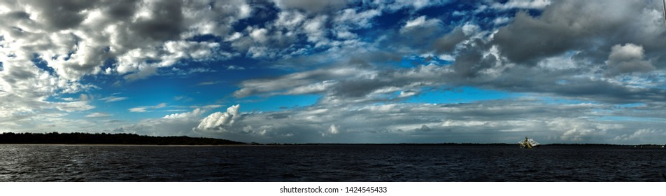 A Vibrant atmospheric nimbostratus cloud formation displayed in a cobalt blue  sky. Beauty in nature background. Gosford, New South Wales, Australia.