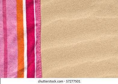 vibrant beach towel on the sand.