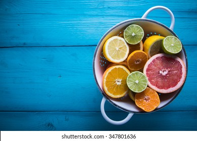 Vibrant citrus half cut fruits on wooden table