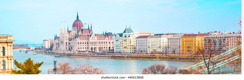 Vibrant city panorama with Hungarian Parliament, Danube river, houses, Budapest, Hungary