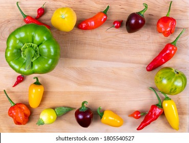 vibrant color garden vegetable mix varieties on a wood plank background tomato pepper and zucchini ball