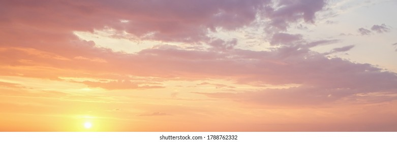 Vibrant color panoramic sun rise and sun set sky with cloud on a cloudy day.