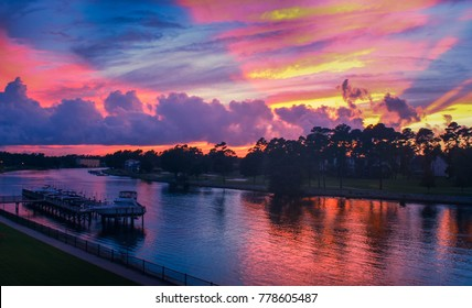 Vibrant, colorful cotton candy skies with pink, blue, purple and yellow streaks of color reflecting in the waterway. Taken in Myrtle Beach, South Carolina