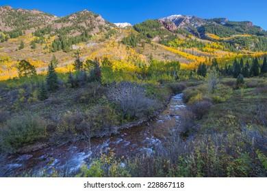 Vibrant Colorful Fall foliage Maroon Creek near Maroon Bells