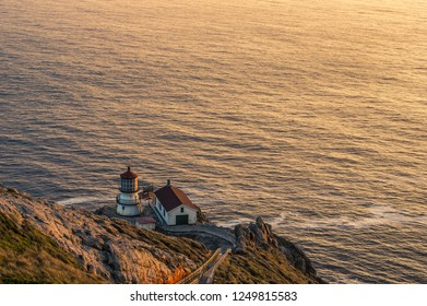 Vibrant and colorful sunset photo of lighthouse at pacific coast USA. Point Reyes Lighthouse near San Francisco California.