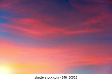 Vibrant colors of the sky with clouds during sunset.