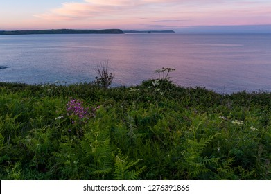Vibrant colours of Cornish coast at dusk, Portscatho, Roseland Peninsula, Cornwall, England