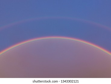 The vibrant colours formed by a rainbow.
