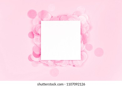 Vibrant confetti on pastel pink background with white clean blank for your text. Festive backdrop for your design.