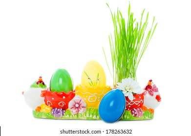 Vibrant easter eggs and green grass in a multicolor holder