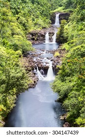 A vibrant image of Umauma Falls in Hawaii shows the three tier cascade of a beautiful natural wonder