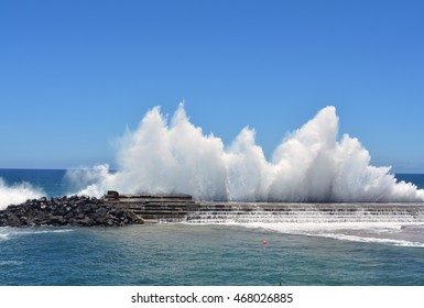 Vibrant image of a wave breaking on a harbour wall