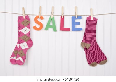Vibrant Image for Your Next SALE featuring the word SALE and Pink Socks.